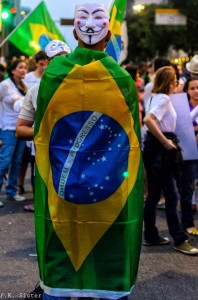Protester with the Brazilian flag and the V for Vendetta mask that became a worldwide symbol of the Social Media Era protests
