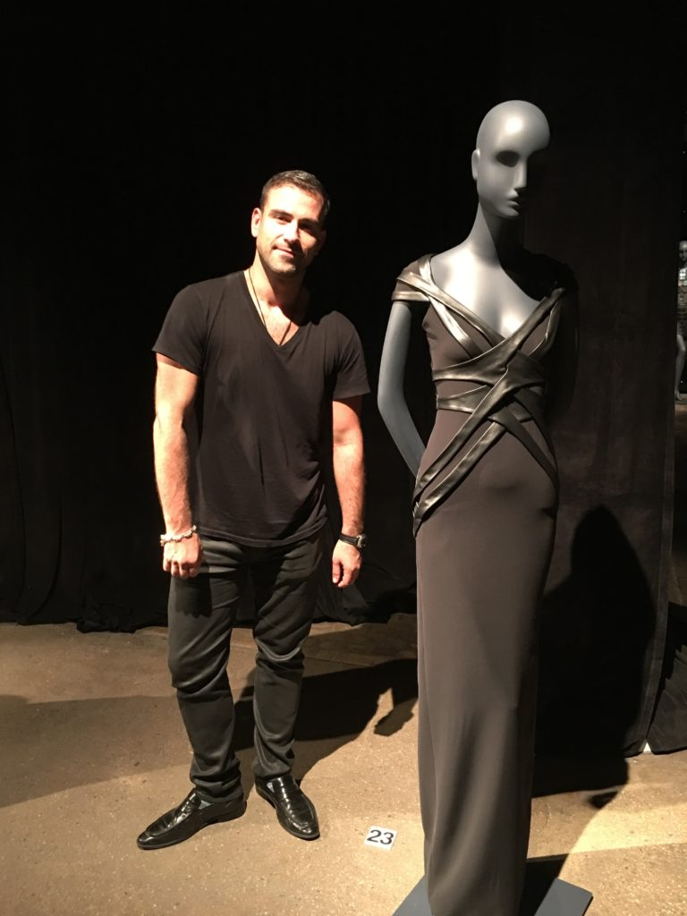 Designer, Rubin Singer Stands by his Ion metallic plisse nova dress s/iridescent leather self-belt